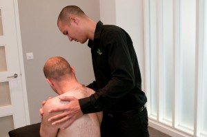 Senior Physiotherapist Tyrone Kon treating back pain